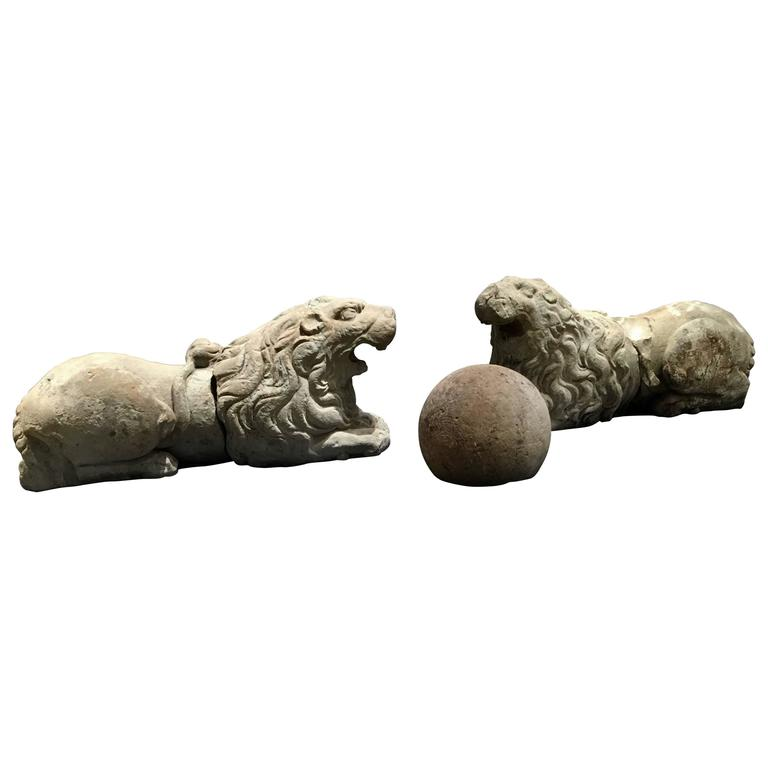 Pair of 17th Century Carved Sandstone Reclining Lions Originally Part of the