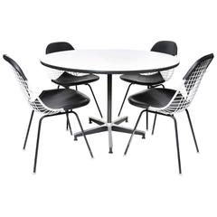 Herman Miller Eames Dining Table and Four Chairs