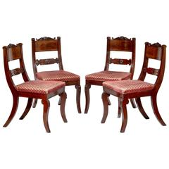 Set of Four Brass-Inlaid Carved Mahogany Klismos Chairs