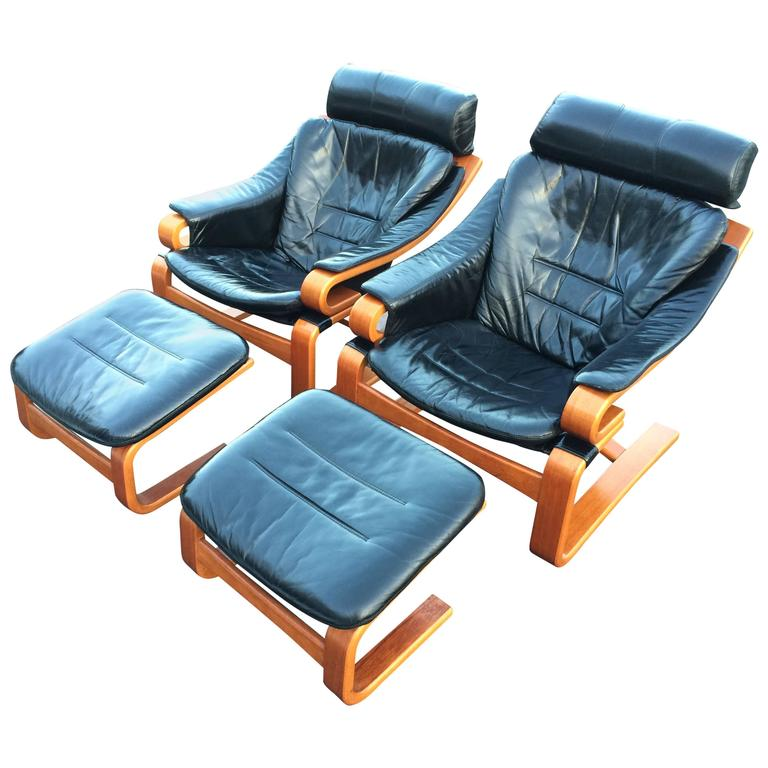 Pair of Danish Modern Leather Lounge Chairs with Ottomans For Sale