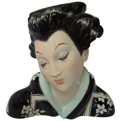 Japanese Porcelain Sculpture of a Geisha