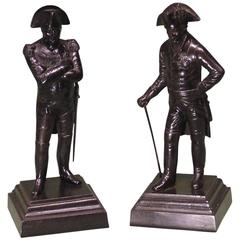 Cast iron figures of napoleon and frederick the great
