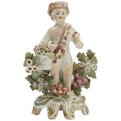Bow Figure of a Putti Holding a Basket of Fruit, circa 1765