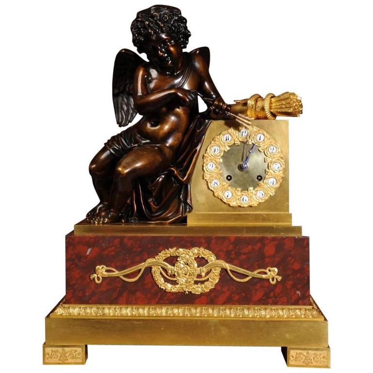 Early and Fine Bronze, Ormolu and Specimen Marble Clock with Cupid For Sale