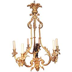 Gilt Bronze Cage Form Chandelier with Patinated Cherub