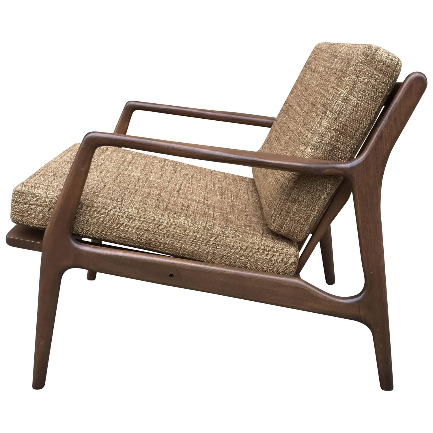 This sculptural pair of lounge chairs by ib kofod larsen is no longer - Mid Century Modern Walnut Lounge Chair By Ib Kofod Larsen For Sale At 1stdibs