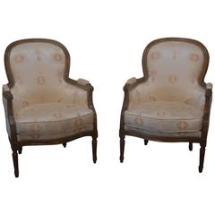 Pair of Carved Cherry French Bergère Chairs