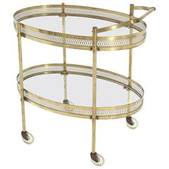 Oval Pierced Brass and Glass Two-Tier Tea Serving Cart on Wheels