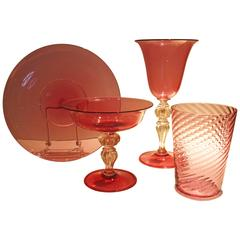Extensive Collection of Cranberry Venetian Glass Stemware, Plates and Tumblers