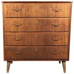 Swedish Veneered Wood and Brass Four-Drawer Chest, 1950s