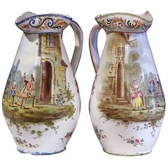 Pair of 19th Century, French, Hand-Painted Faience Wine Pitchers with Scenes