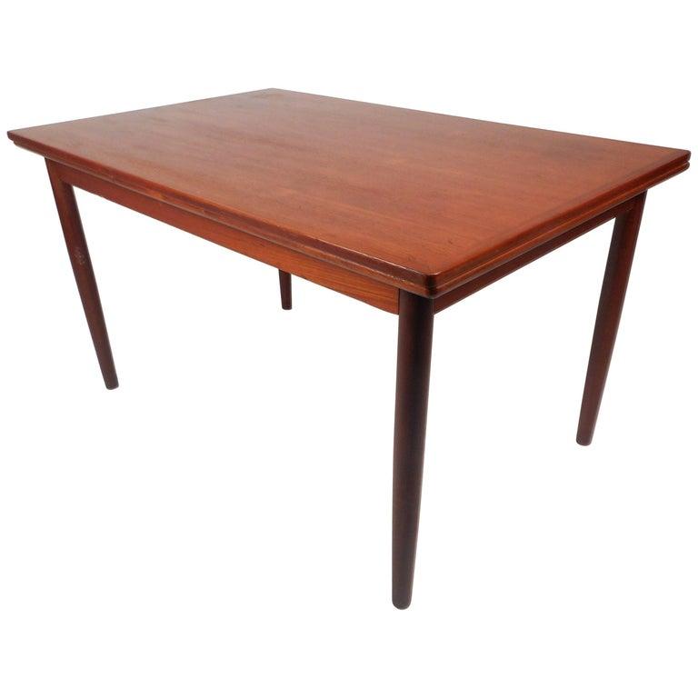 Mid-Century Modern Teak Draw-Leaf Dining Table For Sale