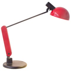 Circa 1970, Guzzini Red and Black Desk Lamp with Heavy Base