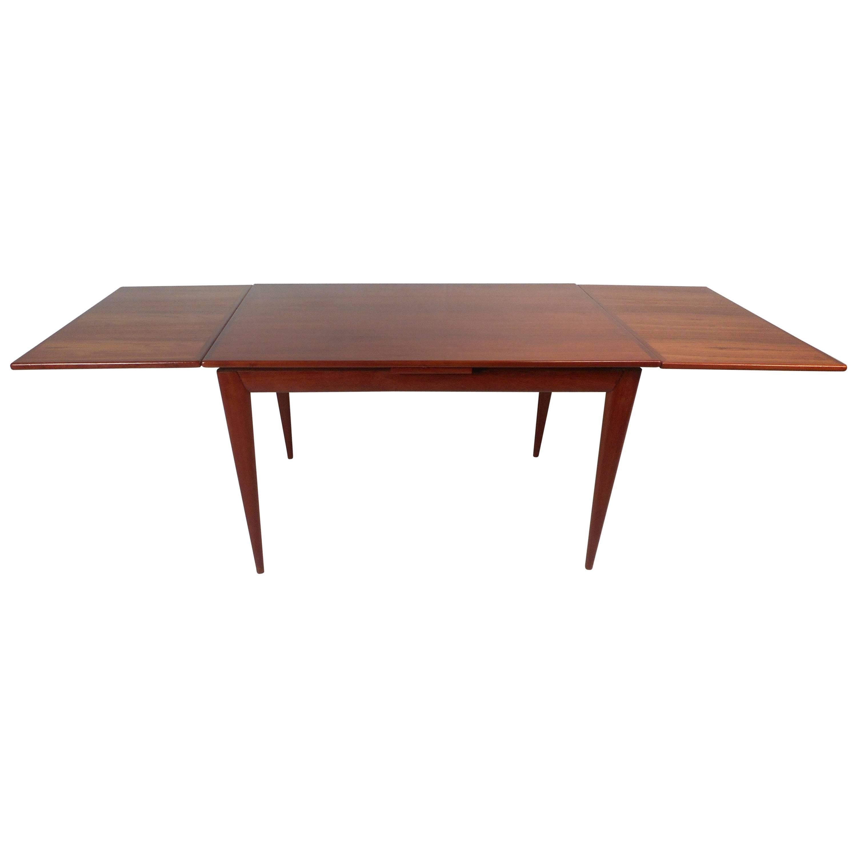 Impressive Mid-Century Modern Teak Draw-Leaf Dining Table by Niels Otto Møller