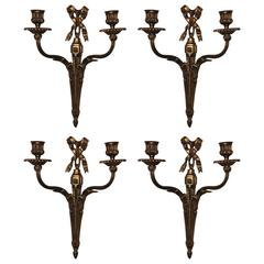 Wonderful French Gilt Bronze Set of Four Bow Top Neoclassical Two-Arm Sconces