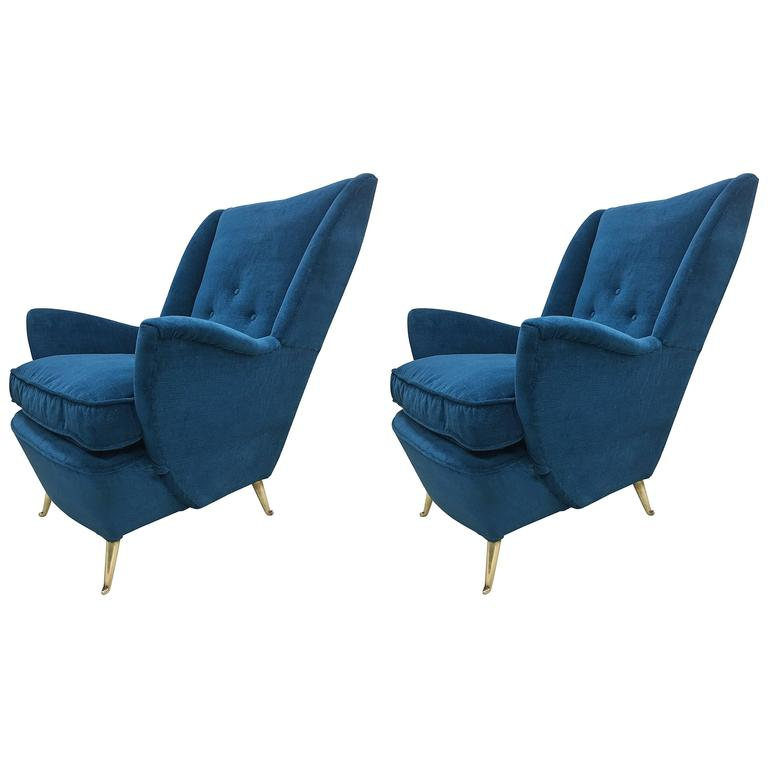 Pair of large italian mid century wingback lounge chairs for Isa arredamenti