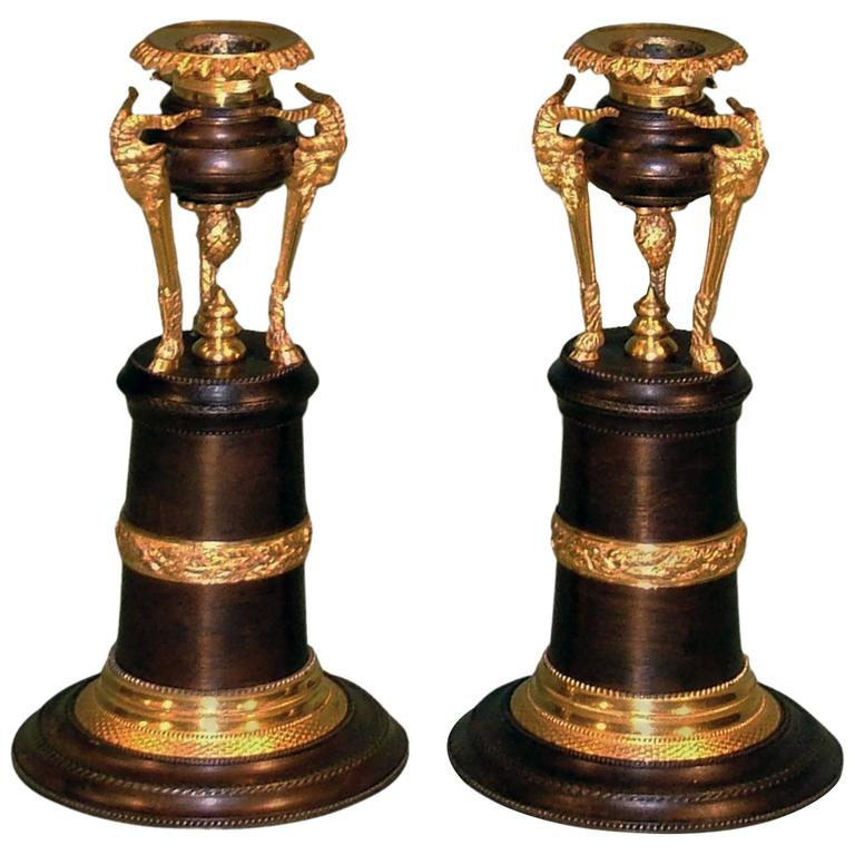 Pair of Regency Bronze and Ormolu and Ram's Head Candlesticks For Sale