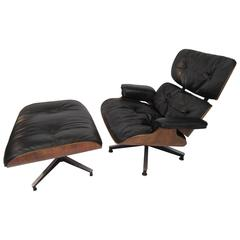 Herman Miller Eames Rosewood Lounge Chair and Ottoman Black Leather, circa 1960s