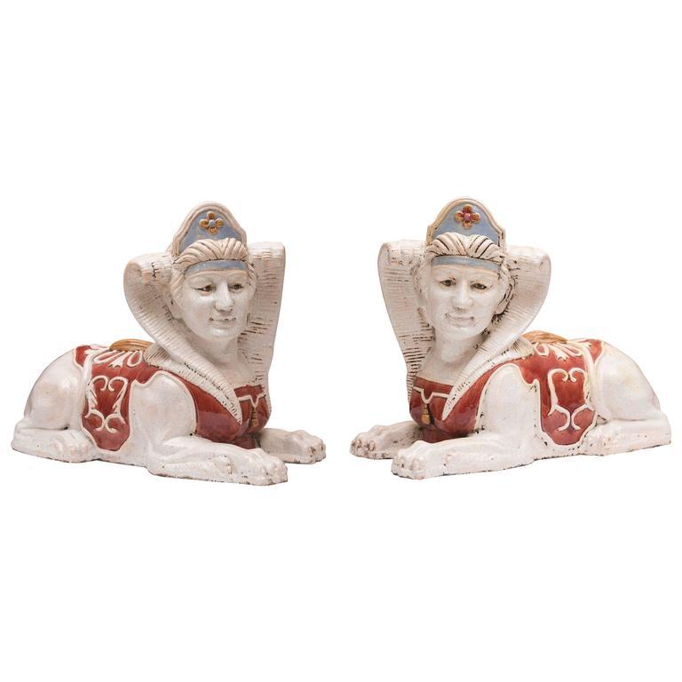 Pair of Glazed Terra Cotta Sphinx Figures