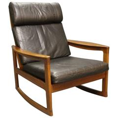 Rocking Chair in Teak and Black Leather by Ole Wanscher and Komfort, 1960s