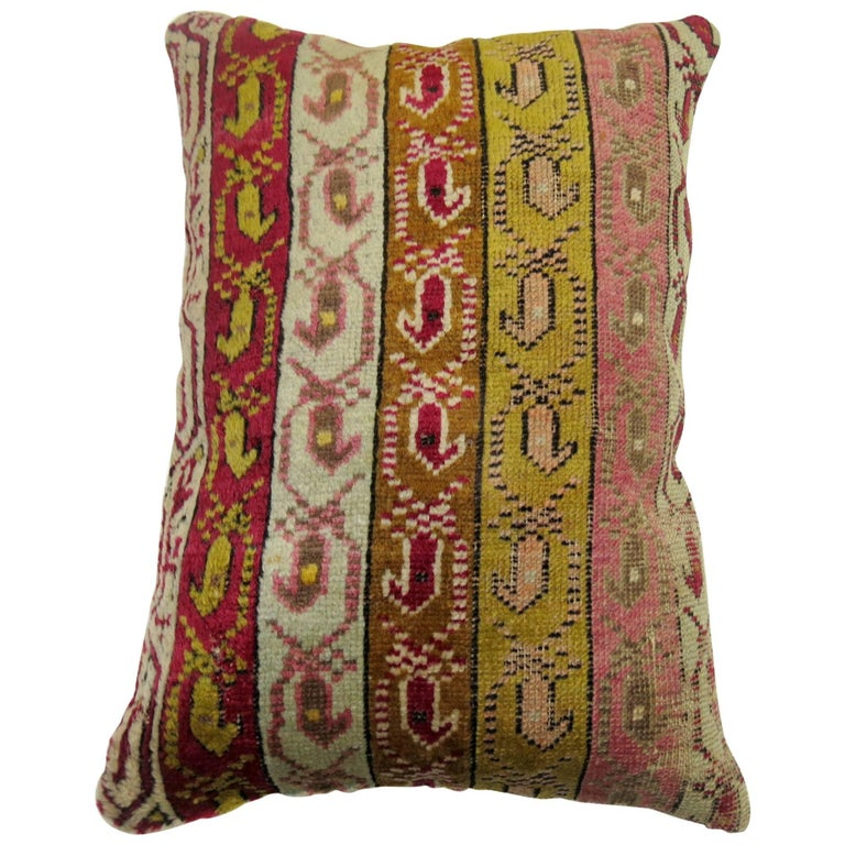 Pillow made from an early 20th century Turkish ghiordes rug.  Measures: 16