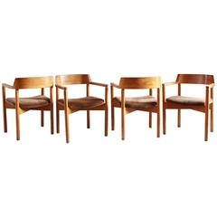 Set of Four Oak Curved Backed Dining Chairs with Brown Corduroy Seat Cushions