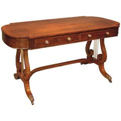 Regency period rosewood writing table with lyre supports