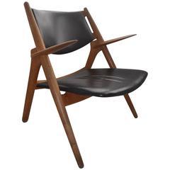 Danish Oak and Leather CH28 Sawbuck Lounge Chair by Hans Wegner for Carl Hansen