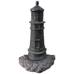 Cast Iron Doorstop in Lighthouse Form