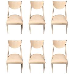 Six Sleek Lacquered Dining Chairs