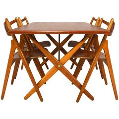 Hans J. Wegner Dining Set Table AT303 and Sawbuck Chairs
