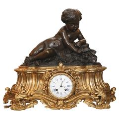 Large 19th Century Gilt Bronze Clock with Patinated Putto Mounted on the Top