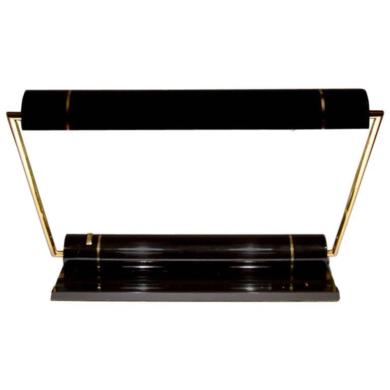 Slick Adjustable Desk Lamp in Black and Brass Attributed to Kovacs