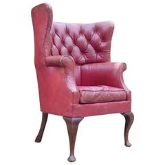 Button Back Barrel Back Leather Wing Chair by Howard and Sons of London