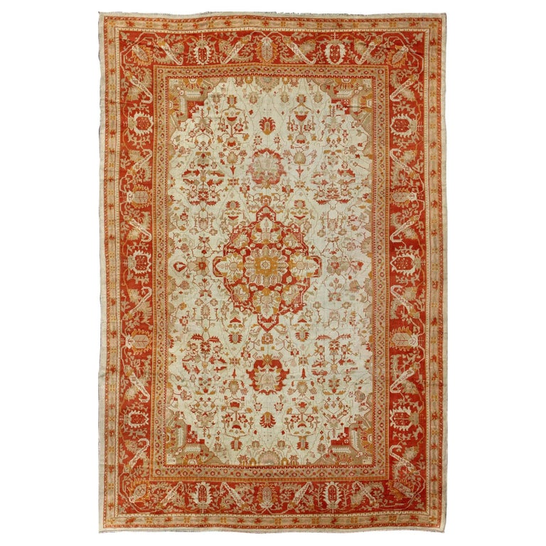 Turkish Ground Rug: Antique Oushak Rug From Turkey With Floral Motifs In Red
