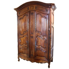 French 1740s Louis XV Period Fruitwood Two-Door Armoire with Raised Panels