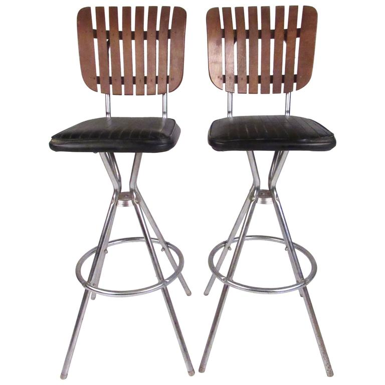 Pair Of Mid Century Modern Slat Back Swivel Bar Stools For