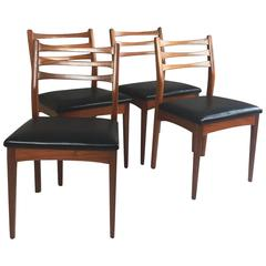 Set of Four 1960s Mid-Century Teak and Vinyl Dining Chairs My Meredrew
