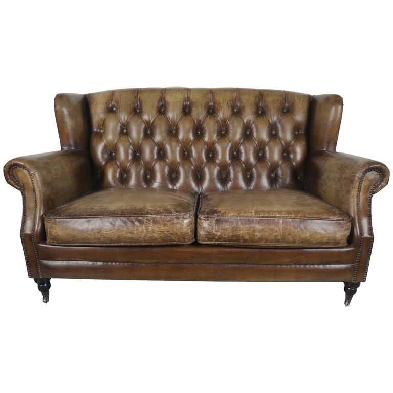 havertys distressed leather nailhead large sofa   English Leather Tufted Sofa with Nailhead Trim Detail at ...