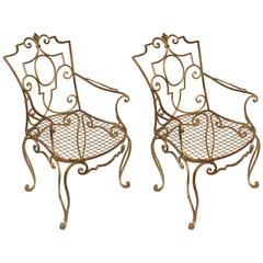 Flamboyant Pair of Jean- Charles Moreux Gilded Armchairs