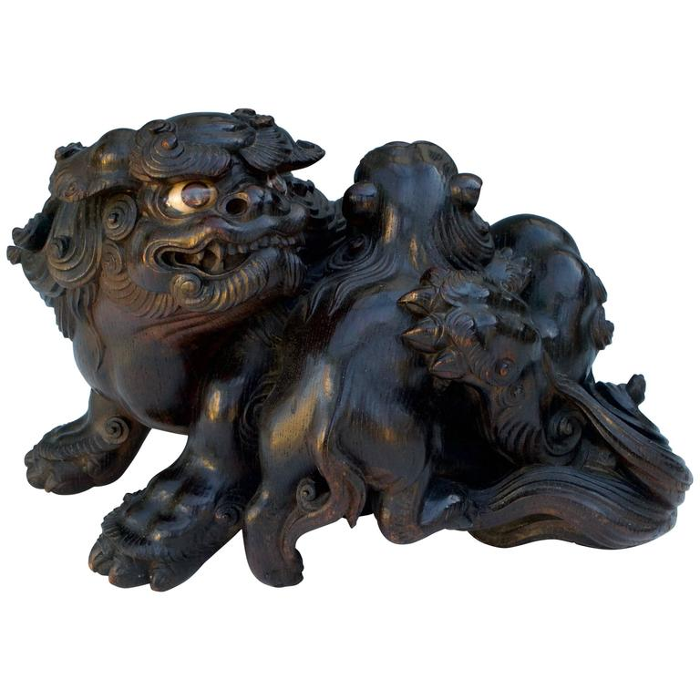 Japanese wood sculpture okimono of two lions for sale at
