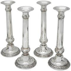 Suite of Four Tall Sterling Silver Neoclassical Candlesticks