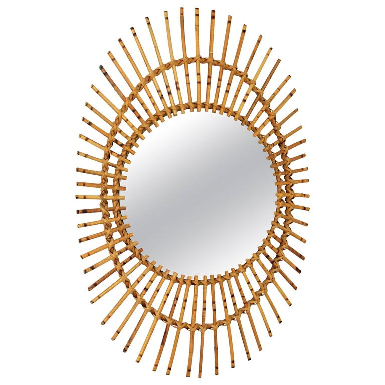 1960s French Rattan Asymmetric Oval Sunburst Mirror