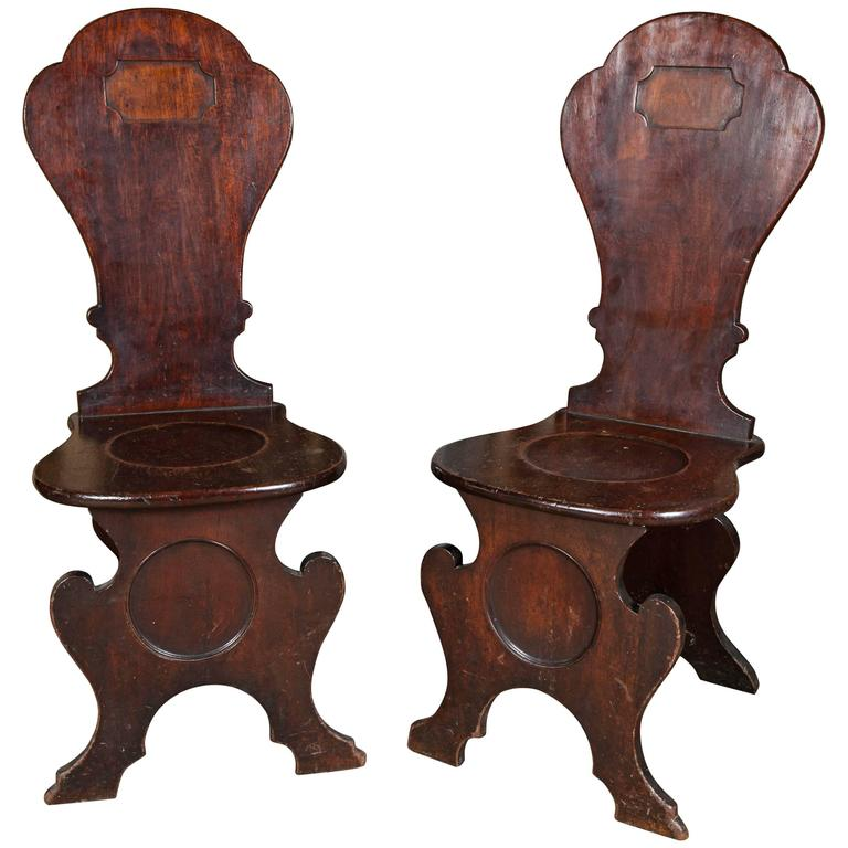 Pair of George II Mahogany Hall Chairs 1