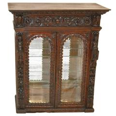 Heavily Carved Gothic Revival Oak Counter Display Cabinet, Figural Carvings