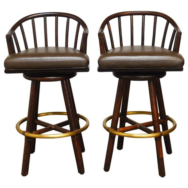 Pair of McGuire Bamboo Rattan and Leather Swivel Barstools