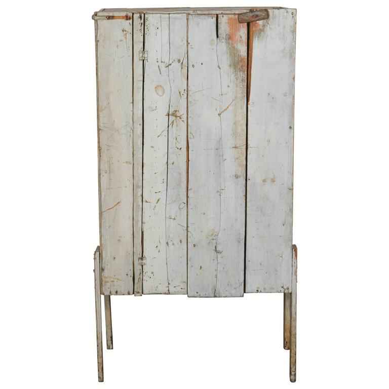 Quirky Rustic Cabinet With Single Wood Plank Door And