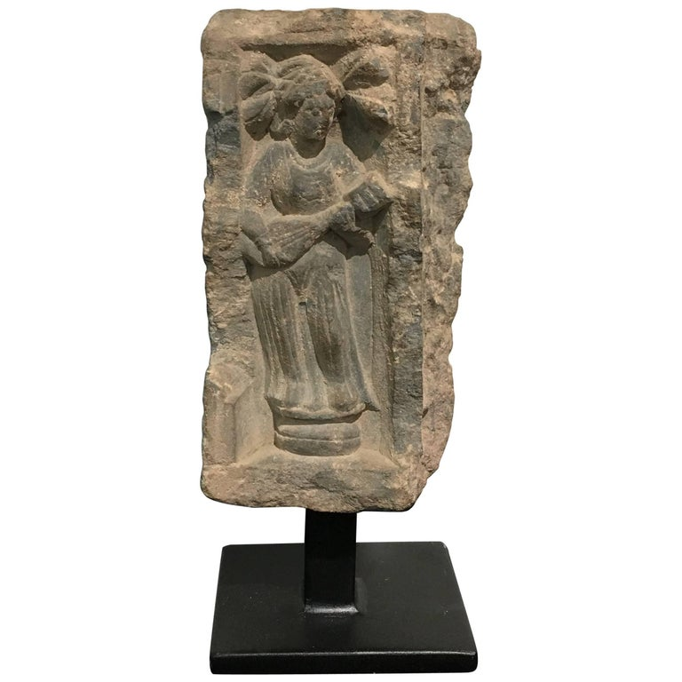 Gandharan Carved Stone Relief Fragment of a Female Musician For Sale