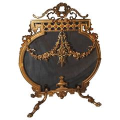 Wonderful French Doré Bronze Fireplace Screen with Ribbons Medallion Firescreen