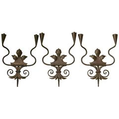 Set of three Coppered Iron Sconces, France, circa 1950s